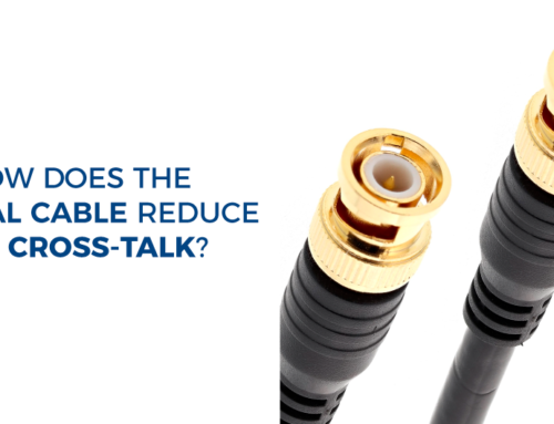 How does the coaxial cable reduce the cross-talk?